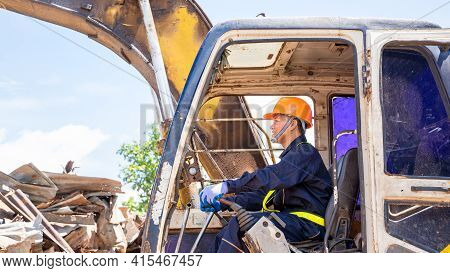 Construction Worker,engineer Working On Junkyard At Waste Recycling Plant,copy Space Available.