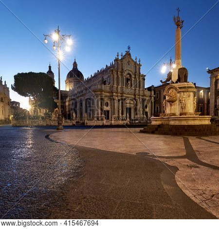 Illuminated Piazza Duomo, Catania, Sicily, Italy In The Evening. Cathedral Of Santa Agatha And Liotr