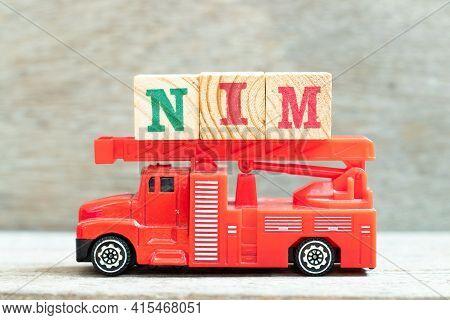 Fire Ladder Truck Hold Letter Block In Word Nim (abbreviation Of Net Interest Margin) On Wood Backgr
