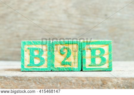 Color Alphabet Letter Block In Word B2b (abbreviation Of Business To Business) On Wood Background