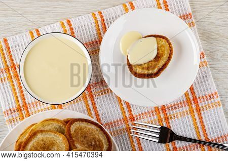Bowl With Condensed Milk, Pancake Poured Condensed Milk In White Saucer, Plate With Pancakes, Fork O
