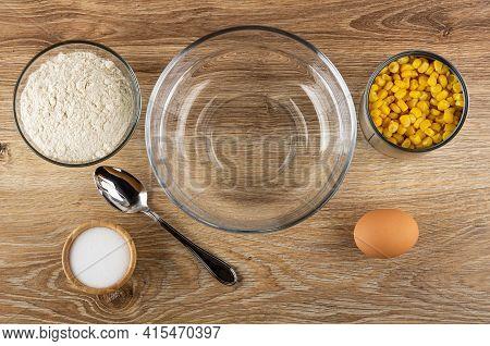 Ingredients For Corn Pancakes. Bowl With Flour, Spoon, Salt Im Bamboo Bowl, Empty Transparent Bowl,