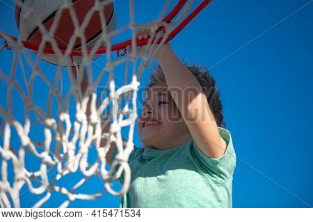 Basketball Child Player Running Up And Dunking The Ball. Funny Excited Child Sportsman. Extreme Kids