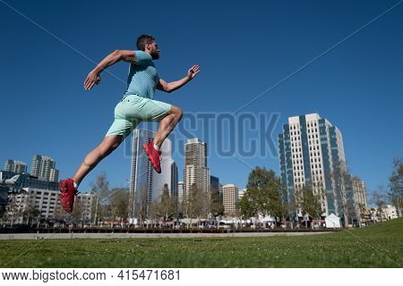 Athlete Runner Feet Running In City Park. Jogging Concept At Outdoors. Man Running For Exercise On C