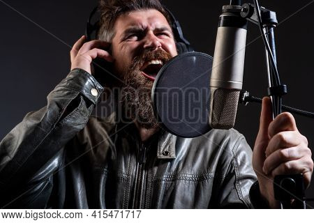Man With Microphone Singing Song. Musician In Music Hall. Funny Guy Singing In Karaoke