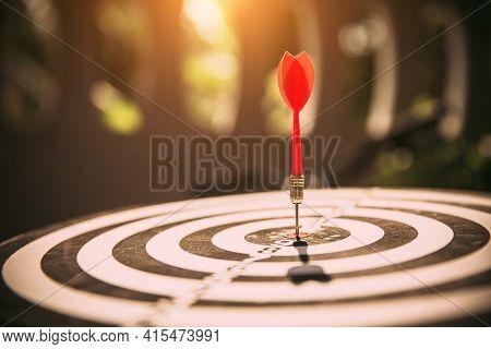 Close-up The Bullseye Or Bulls Eye Target Or Dart Board Has Dart Arrow Throw Hitting The Center Of A