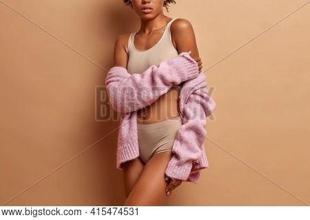 Pefect Slim Body Of Woman Posing Against Beige Background. Fit Female Models In Underwear Demonstrat