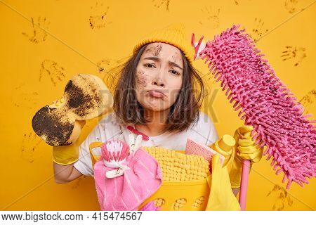 Dirty Displeased Young Brunette Asian Woman Looks Unhappily Removes Dirt With Sponge Holds Dirty Mop