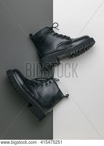A Pair Of Stylish Youth Rough Boots On A Gray And White Background. Rough Stylish Shoes.