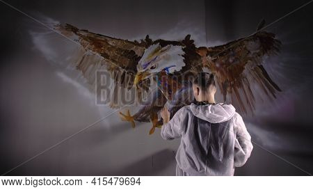 Artist Designer Draws An Eagle On The Wall. Craftsman Decorator Paints Picture With Acrylic Oil Colo