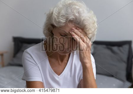 Upset Senior Lady Suffering From Headache Or High Blood Pressure