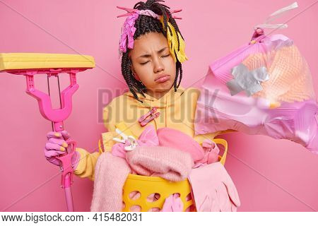 Fatigue Sleepy Housewife With Dreadlocks Closes Eyes Feels Tired Holds Garbage And Mop Does Laundry