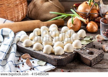 Homemade Dumplings Of Their Dough And Minced Meat, A Set Of Products For Cooking: Flour, Dough, Minc