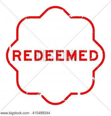 Grunge Red Redeemed Word Rubber Seal Stamp On White Background