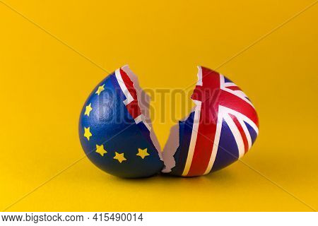 Two Halves Of Cracked Eggshell, One Of Which Is Decorated With The Flag Of Europe, And The Other Wit