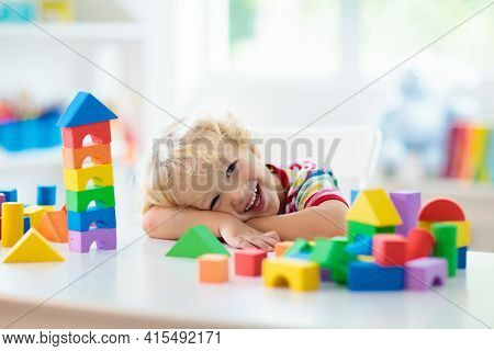 Kid Playing With Colorful Toy Blocks. Little Boy Building Tower Of Block Toys. Educational And Creat