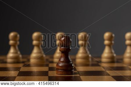 One Black Pawn Against Many Others. Different Against Monopoly. Challenge Concept