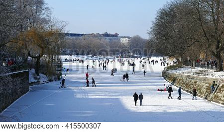 Berlin, Germany, February 14, 2021, Winter Scene With Walkers And Skaters At The Frozen Urbanhafen I