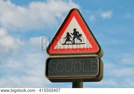 Swiss Italian Warning School Street Sign With Italian Scuole Inscription Against A Blue Sky Located