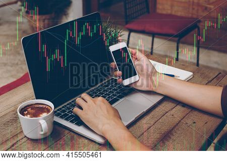 Trader Holding In Hands A Smart Phone And Researching Stock Market To Proceed Right Investment Solut