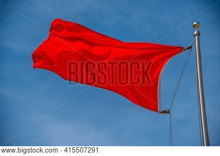 Red Warning Flag At The Beach Red Fabric Cloth In Blue Sky. Wavy Background Communist, Communism, Re