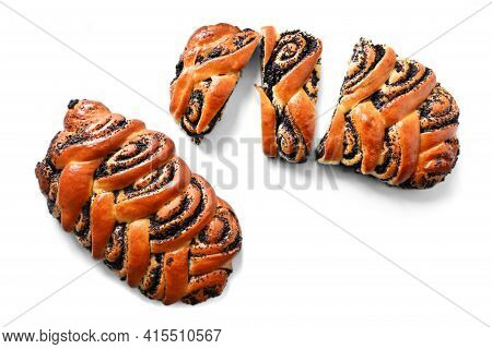 Sliced Roll With Poppy Seeds, Baked At Home On A White Background Close-up. Homemade Cakes. Bread Te
