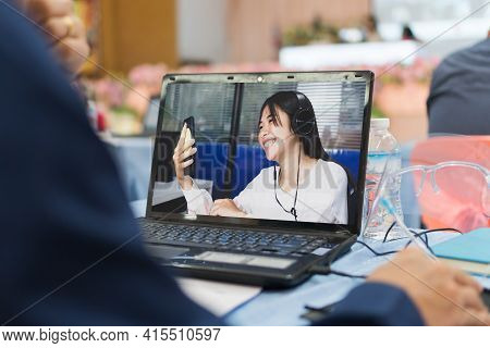 Attractive Beautiful Student Learning Online Education Technology Wearing Headphone To Teacher Elear