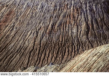 Background Texture From A Mottled Slope Of A Hill, Moving From The Wind And Moisture, Strewn With Sa