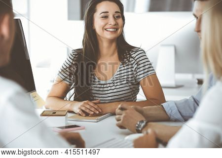 Group Of Business People Discussing Questions At Meeting. Headshot Of Casual Dressed Businesswoman H