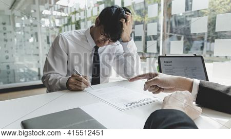 Man is signing a contract with the company, Supervisor orders the employee to sign the resignation d