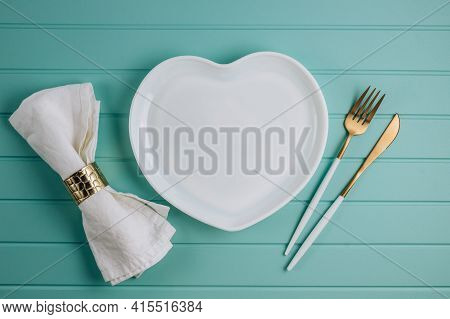 Shape Of Heart Plate And Cutlery. Romantic Table Setting.