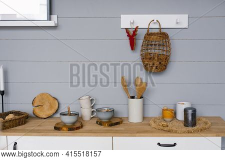 Modern Kitchen Interior With Gray Wooden Panels On The Wall In Scandinavian Style, Crockery And Kitc