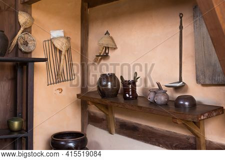 Korean Tradition Kitchen - Korean Antique Cooking Utensils On A Background Of Brown Wall.