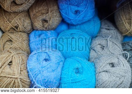 Multicolored Yarn Balls In Knitting Shop Center. A Lot Of Color Yarn For Knitting. Colorful Blue, Br
