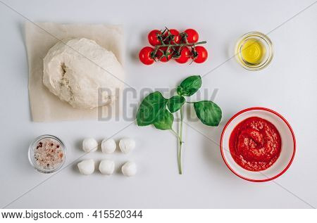 Composition With Fresh Basil, Dough, Mozzarella, Olive Oil. Ingredients For Margherita Pizza Isolate