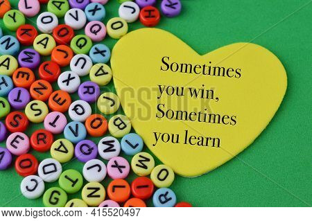 Alphabet Beads And Love Shape With Text Sometimes You Win, Sometimes You Learn
