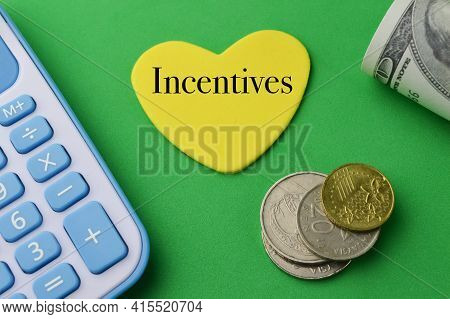 Calculator, Coins And Love Shape Written With Incentives