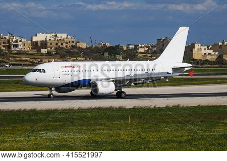 Luqa, Malta - November 30, 2016: Air Malta Passenger Plane At Airport. Schedule Flight Travel. Aviat
