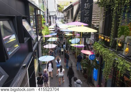 Shanghai, China. October 6, 2015. Chinese Oil Paper Umbrellas Hanging Above The Narrow Alleyways Of