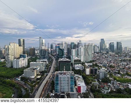 Aerial View Of Highway Intersection And Buildings In The City Of Jakarta And Noise Cloud With Jakart
