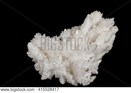 Macro Stone Calcite Mineral On A Black Background