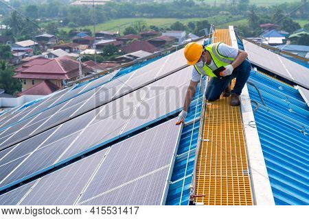 Solar Energy, Asian Engineering Working On Roof At Solar Power Station, Operation And Maintenance In