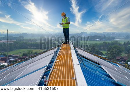 Solar Energy, Asian Engineering Working On Roof Checking And Maintenance In Solar Power Plant , Sola