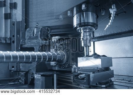 Abstract Scene  Cnc Milling Machine And The Ball Screw. The Hi-precision Of Cnc Machining Center Con