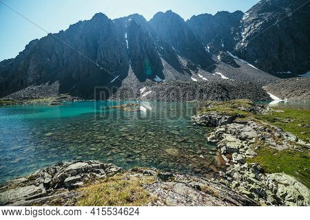 Sunny Mountain Landscape With Azure Glacial Lake In Sunlight. Turquoise Clear Water Of Mountain Lake
