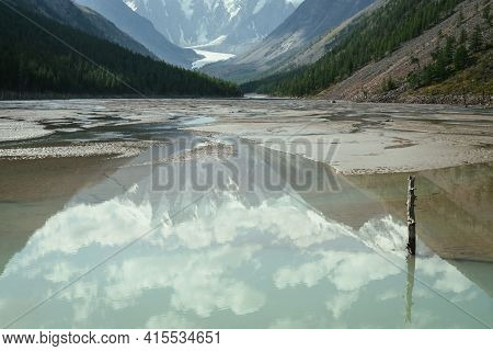 Scenic Alpine Landscape With Beautiful Mirror Mountain Lake With Reflection Of Snowy Mountain And Cl