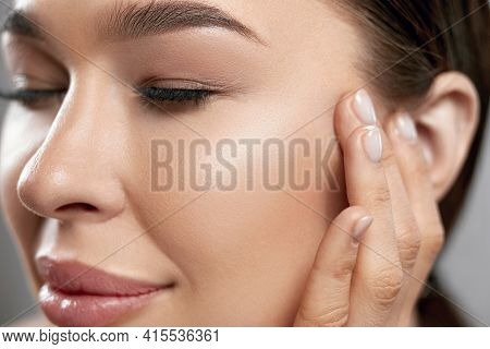 Beauty Face. Woman With Natural Makeup And Healthy Skin Portrait. Beautiful Girl Model Touching Fres