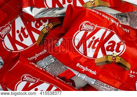 Tambov, Russian Federation - March 19, 2021 Empty sweet wrappers of KitKat candy bars. Full frame.