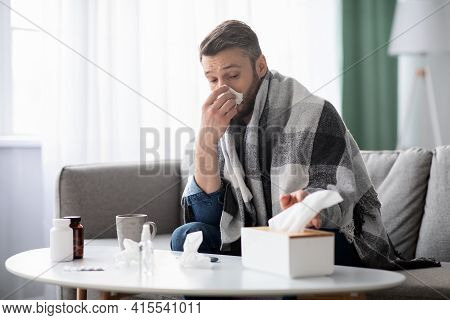 Sick Man Covered In Blanket Sneezing Nose, Taking Napkins