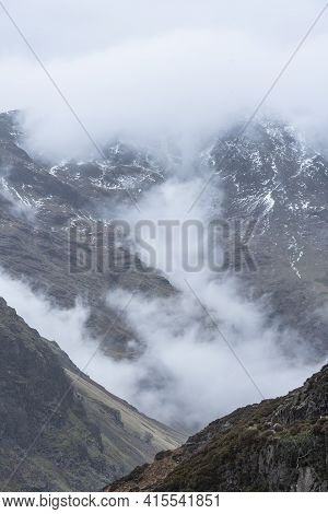 Stunning Winter Landscape Image Of View From Side Pike Towards Langdale Pikes With Low Level Clouds